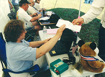 Turning in a competitor card at 2002 championships